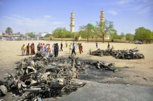 Security and emergency agency staff investigate the Kano Central Mosque bombing scene in Kano