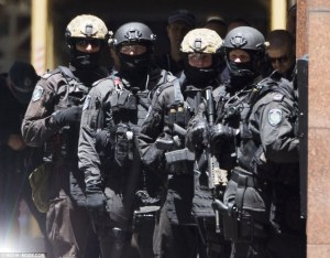 240E362B00000578-2873855-Scores_of_police_have_surrounded_the_cafe_in_Martin_Place_amid_c-a-53_1418607805860