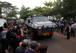 An armoured police vehicle believed to be carrying two Australian prisoners, arrives at the port to take a ferry to the prison island of Nusa Kambangan, where upcoming executions are expected to take place, in Cilacap, Central Java