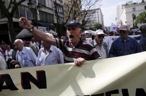 A Greek pensioner shouts slogans during a demonstration for better healthcare in Athens