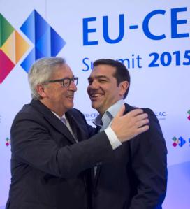 European Commission President Jean-Claude Juncker welcomes Greece's Prime Minister Alexis Tsipras at the start of an EU-CELAC Latin America summit in Brussels