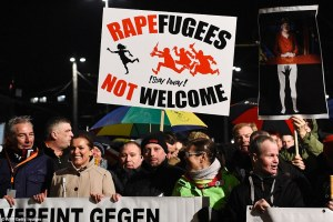 300E127600000578-3394896-Protestors_from_the_PEGIDA_movement_Patriotic_Europeans_Against_-a-15_1452560720093