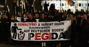 Sympathizers-of-German-right-wing-populist-movement-PEGIDA-attend-their-twelfth-march-in-Dresden-on-Jan.-12-2015-AFP-800x430