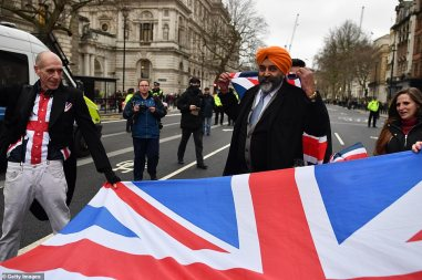 24137934-7954031-Pro_Brexit_supporters_wave_Union_Jack_flags_at_Parliament_Square-a-124_1580526025644