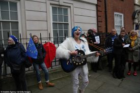 24147034-7954031-The_woman_sporting_blue_stars_on_her_face_sings_and_plays_the_gu-a-66_1580526019345